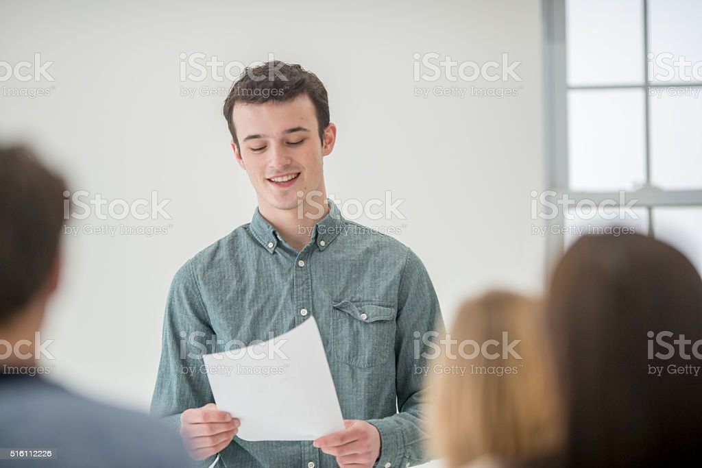 Student Giving a Presentation in Class stock photo