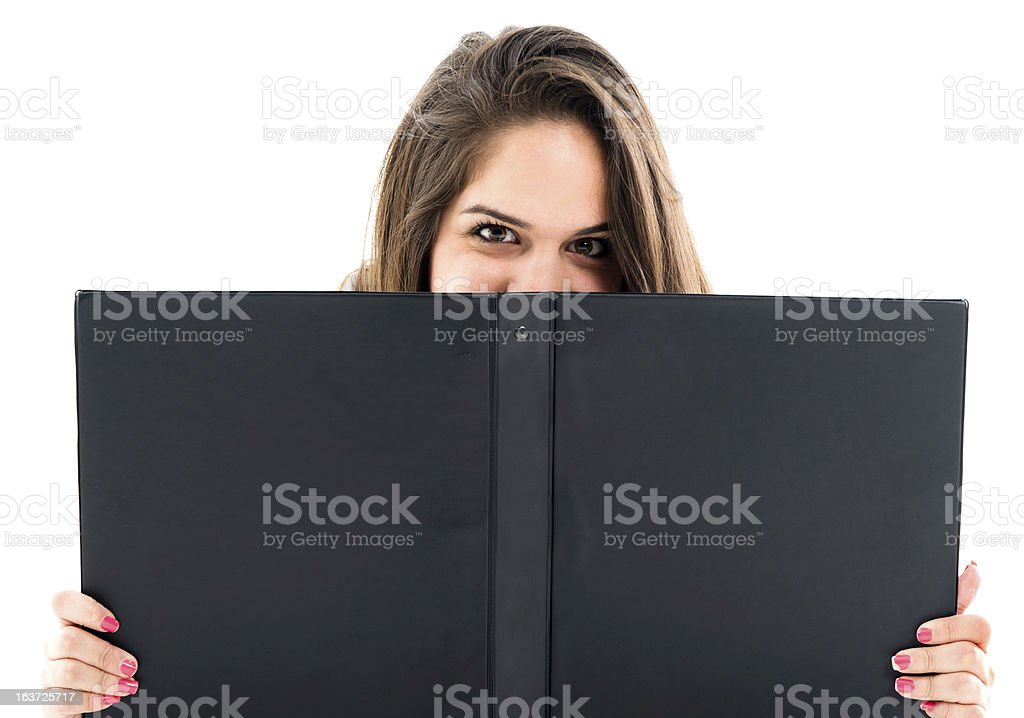 Student hidding behind ring binder royalty-free stock photo