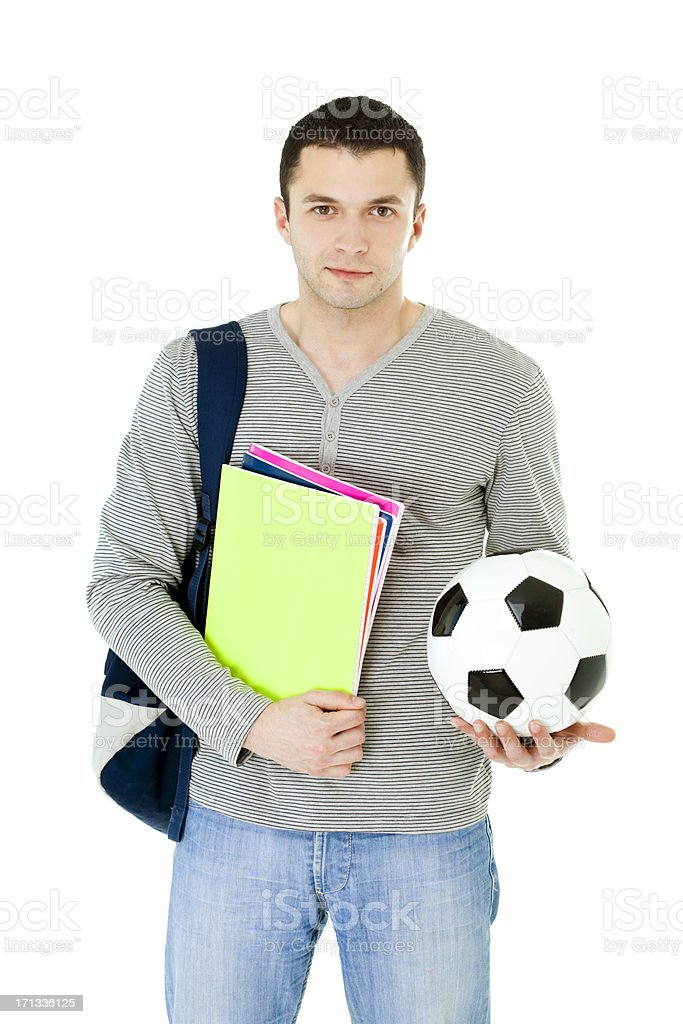 student holding books and soccer ball royalty-free stock photo