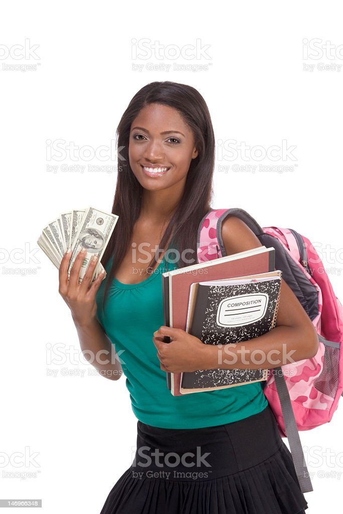 Student holding money representing financial aid and loans stock photo