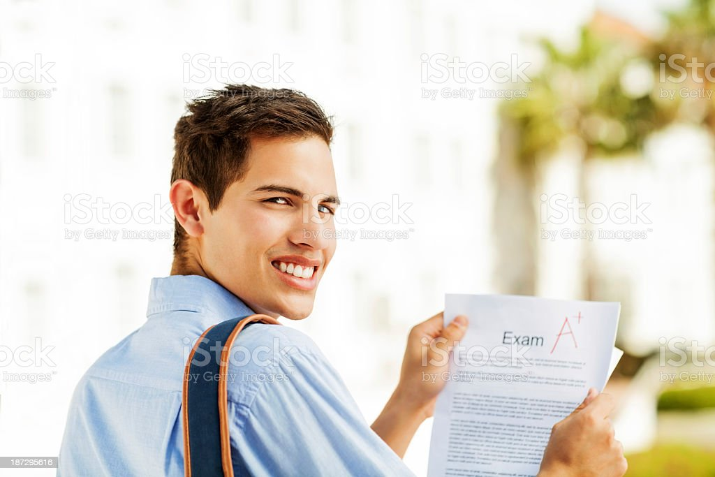 Student Holding Test Result With A+ Grade On Campus royalty-free stock photo