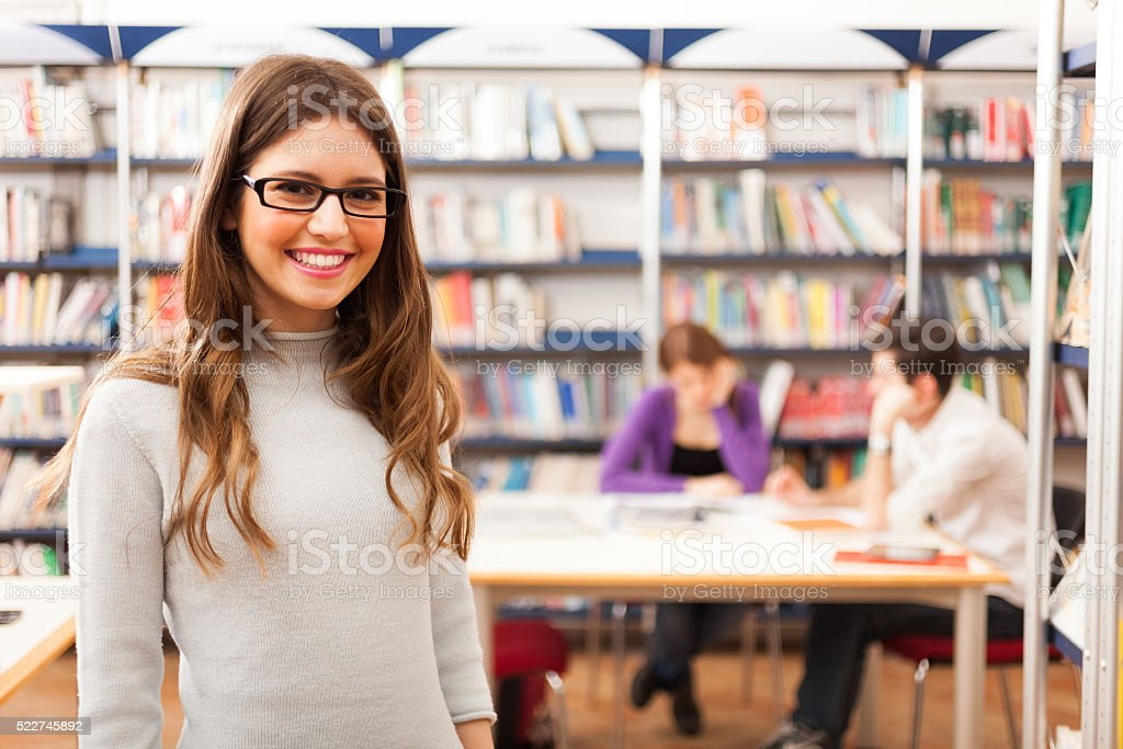 Student in a library stock photo