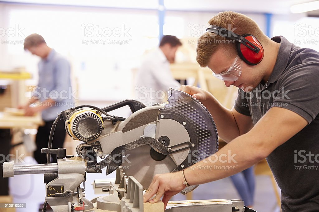 Student In Carpentry Class Using Circular Saw stock photo
