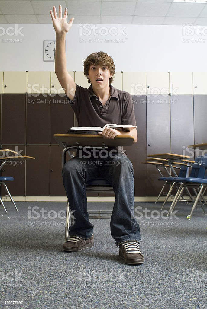 Student in class waiting to ask question royalty-free stock photo