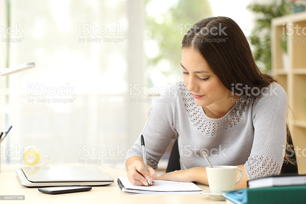Student learning taking notes stock photo