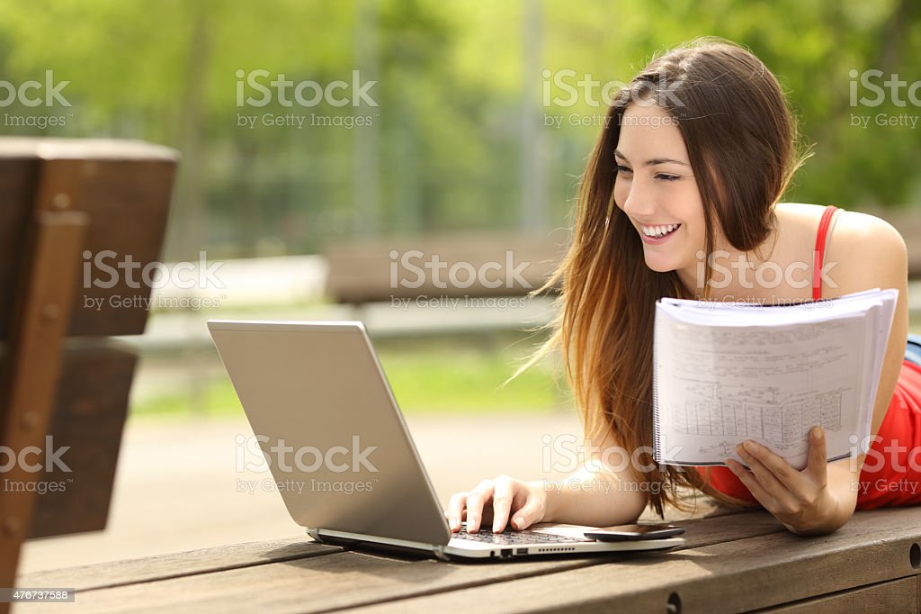 Student learning with a laptop in an university campus stock photo