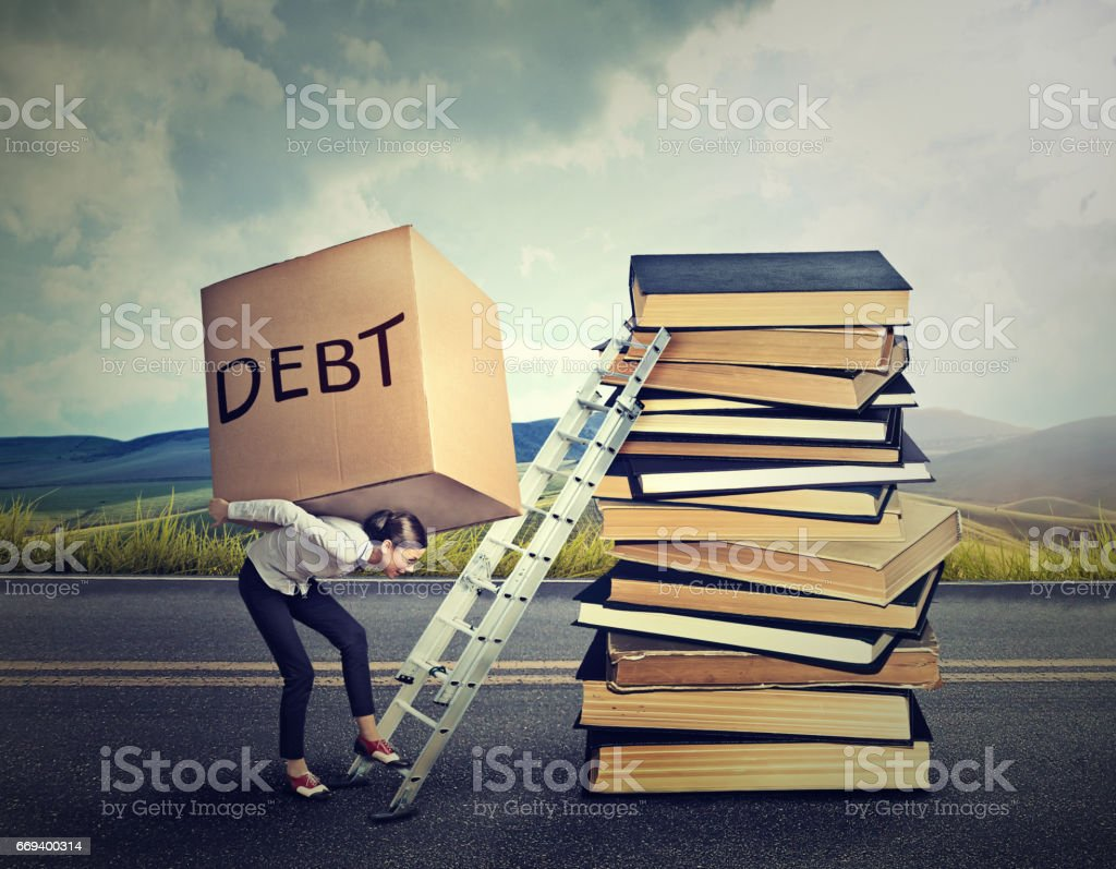 Student loan debt concept. Young woman with heavy box full of debt carrying it up the education ladder stock photo