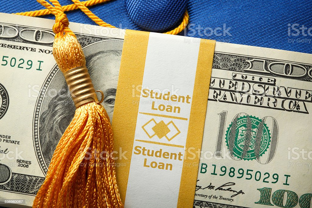 Student Loan Money On A Graduation Cap stock photo