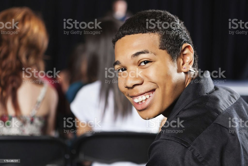 Student looking back and smiling during school event royalty-free stock photo