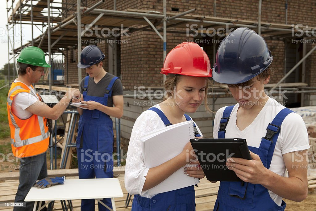 Student making notes. Learning construction worker. royalty-free stock photo