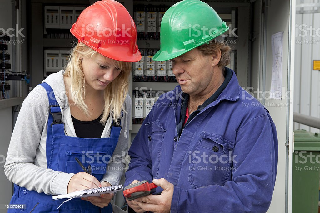 Student making notes. Learning for electrician. royalty-free stock photo