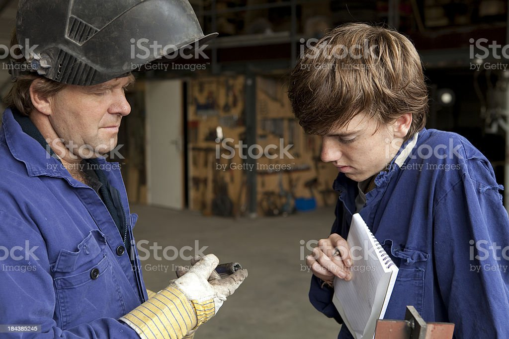 Student making notes. Learning for machinist. royalty-free stock photo