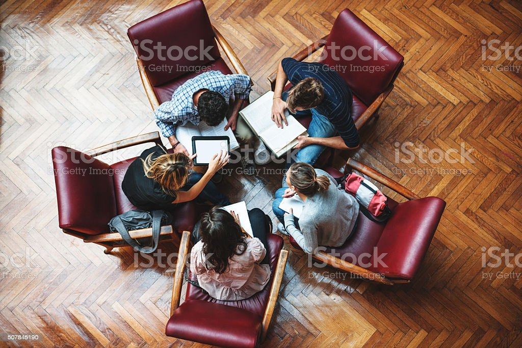 Student meeting in library - Teamwork stock photo