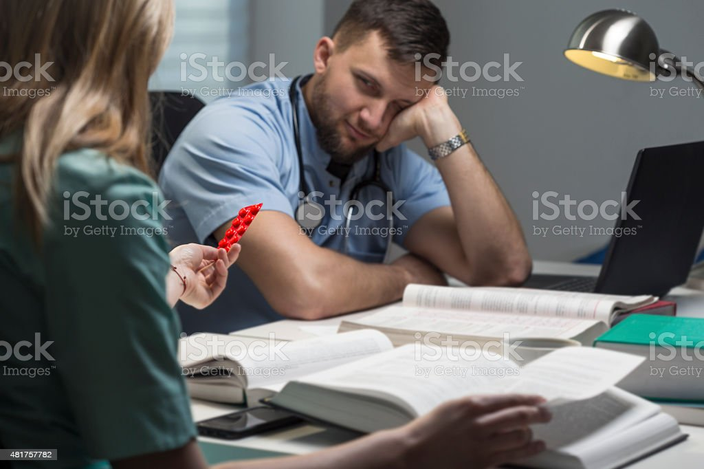 Student of medicine with headache stock photo