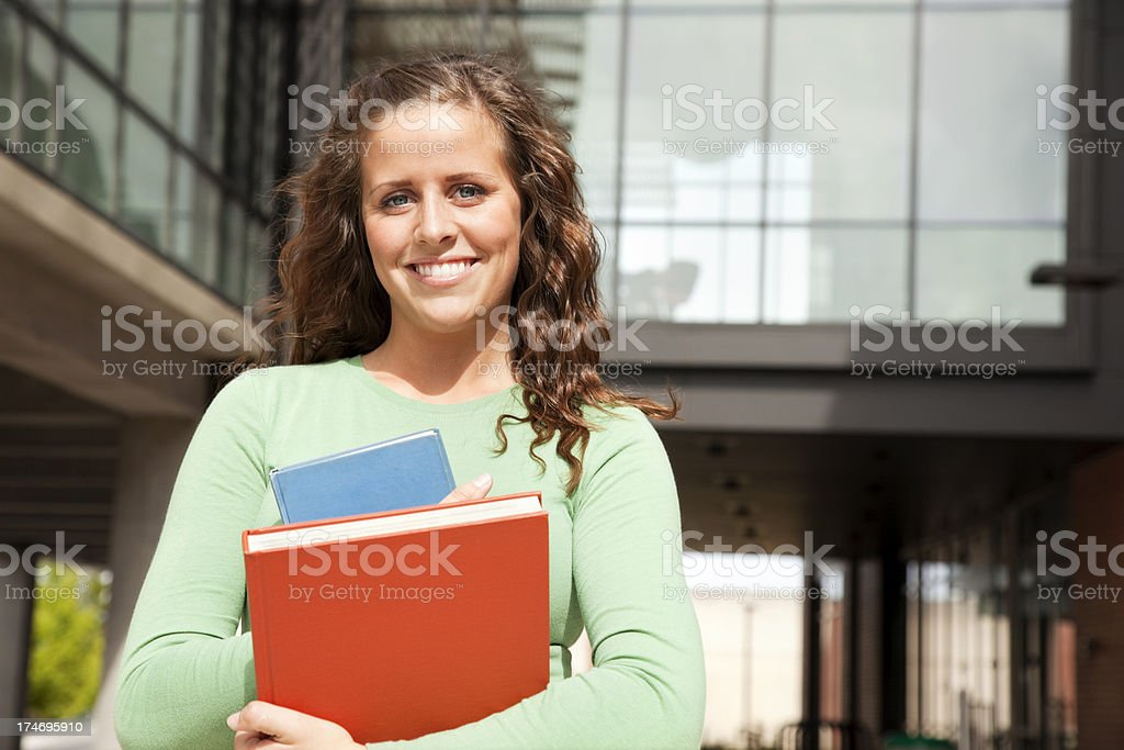 Student on Campus with Textbooks royalty-free stock photo