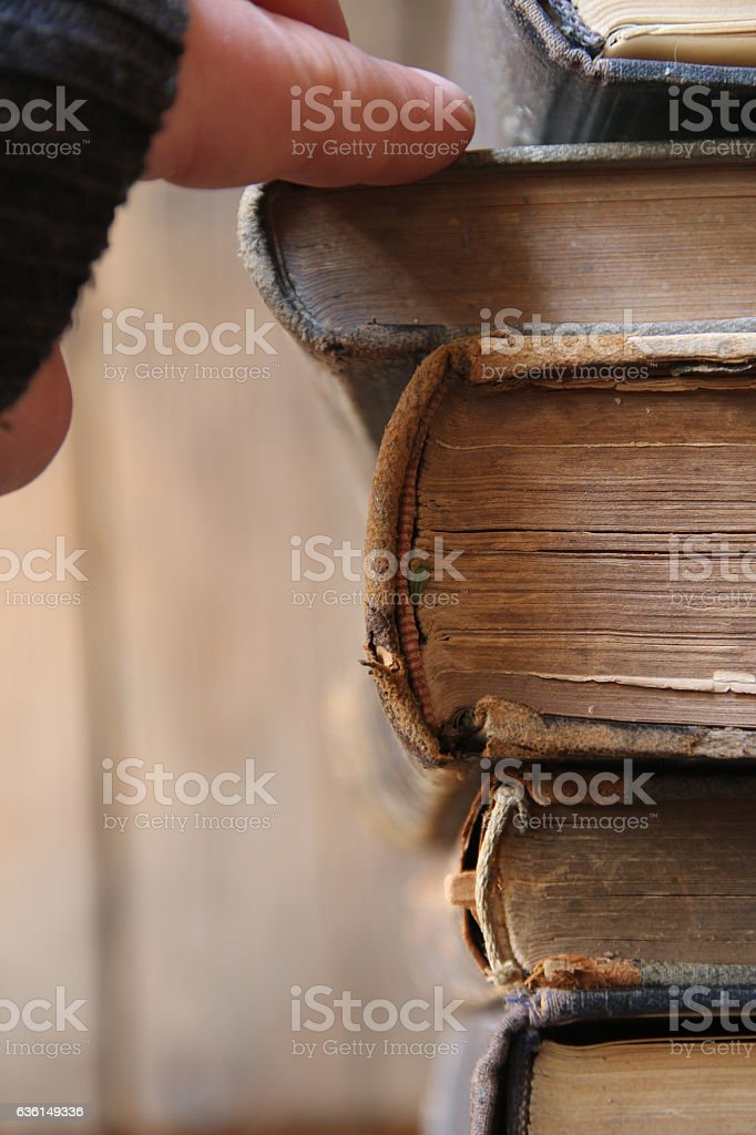 student or scientist takes the book on a shelf in stock photo