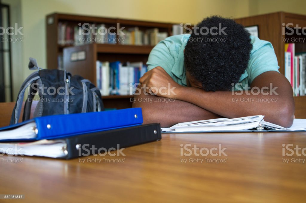 Student overwhelmed with homework stock photo