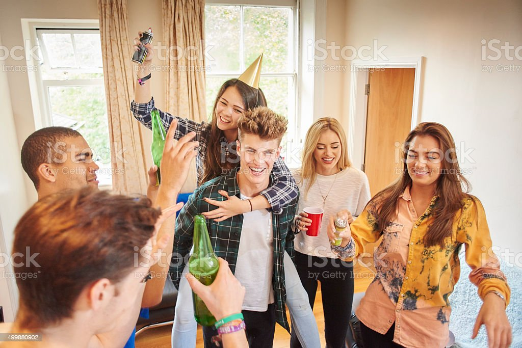 student party shenanigans stock photo