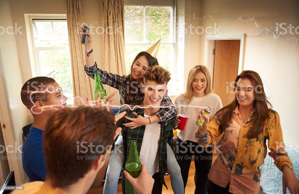 student party shenanigans stock photo