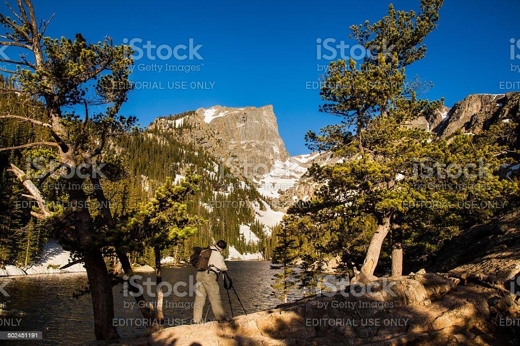 Student Photographs Hallett's Peak from Dream Lake stock photo