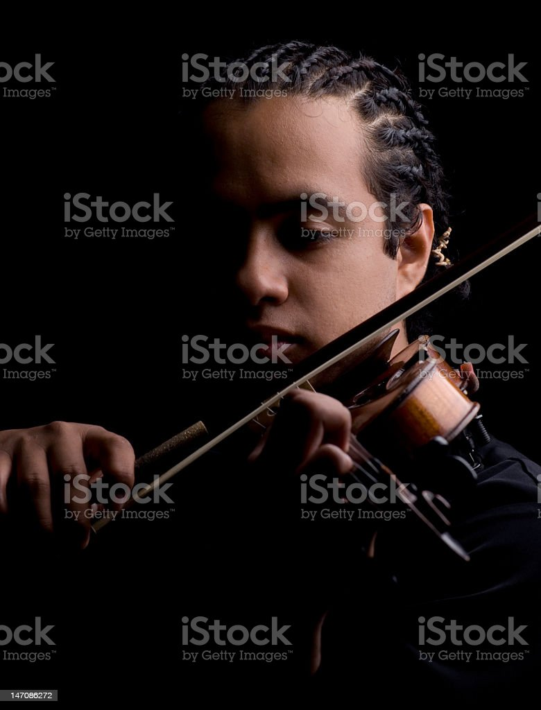 Student playing the violin stock photo