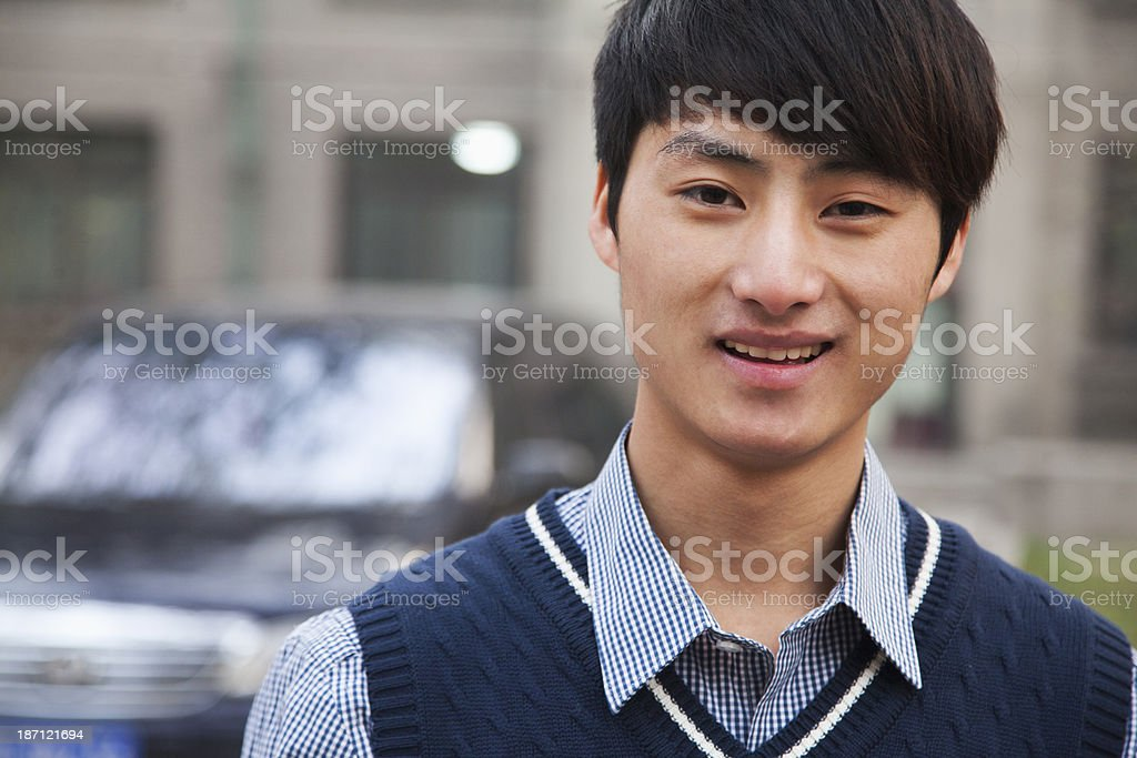Student portrait in front of dormitory at college royalty-free stock photo