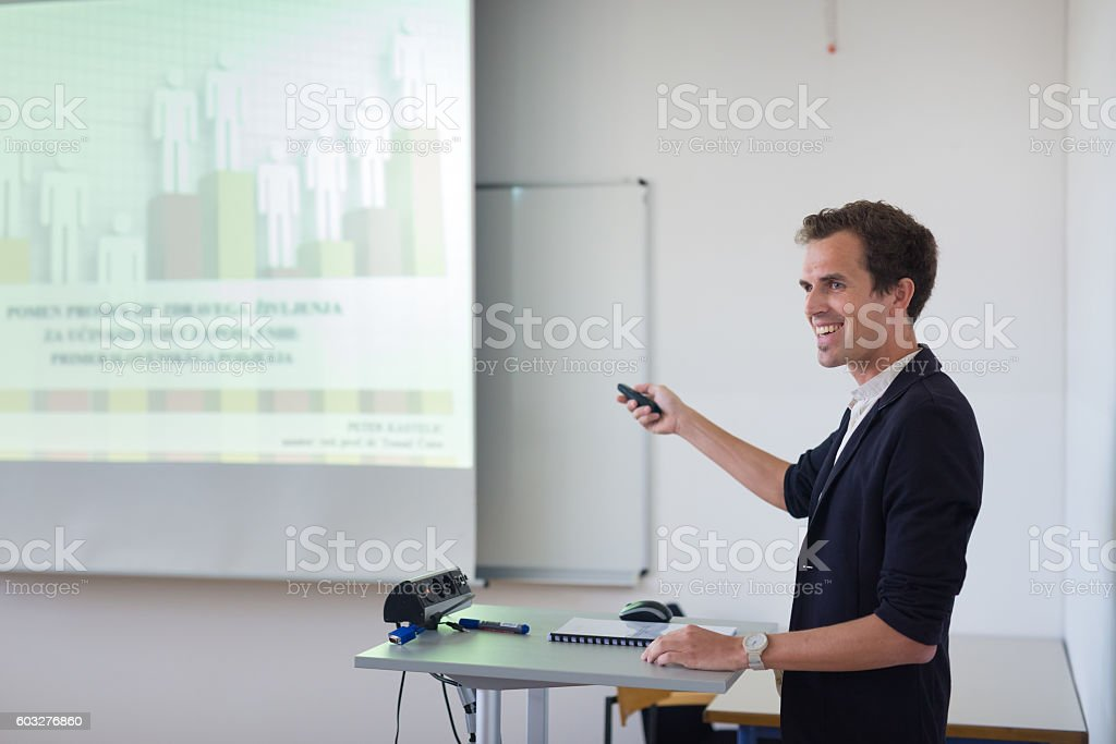 Student presenting his study work in front of whiteboard. Lizenzfreies stock-foto