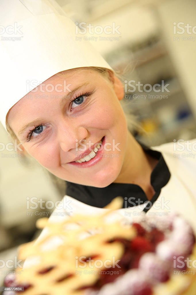 Student proud of her cake stock photo