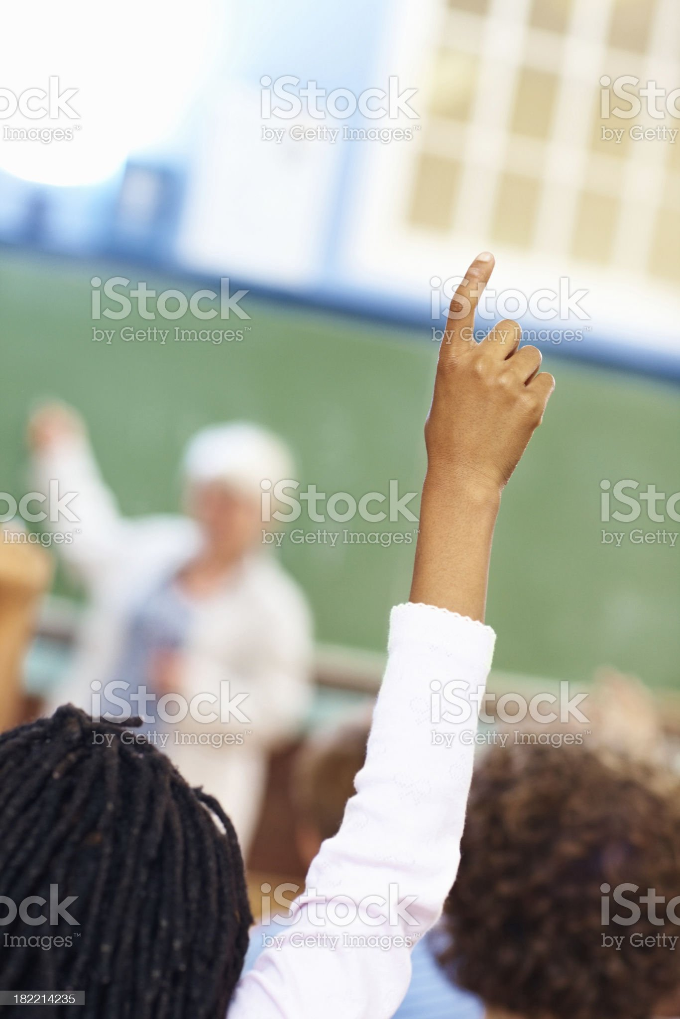Student raising hand to answer the question royalty-free stock photo