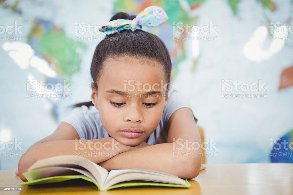 Student reading from a school book stock photo