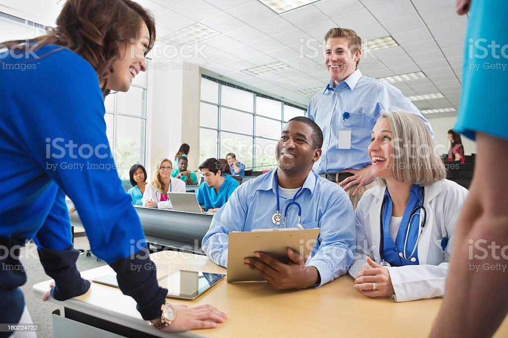 Student registering for college nursing school medical seminar stock photo