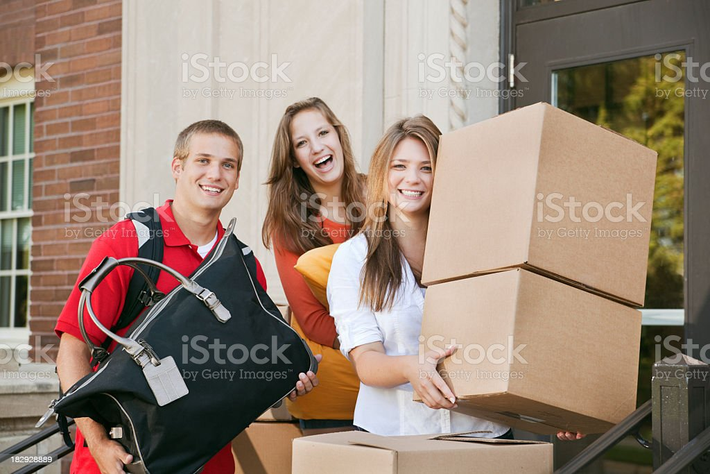 Student Roommates Moving into College Dormitory Apartment on University Campus royalty-free stock photo