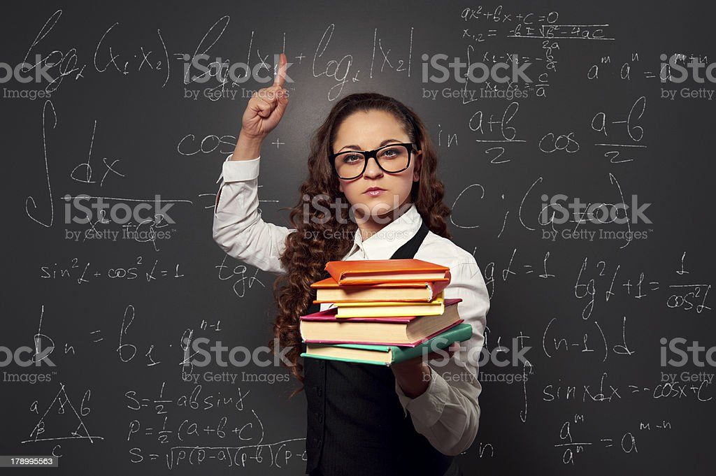 student showing attention sign against chalkboard royalty-free stock photo