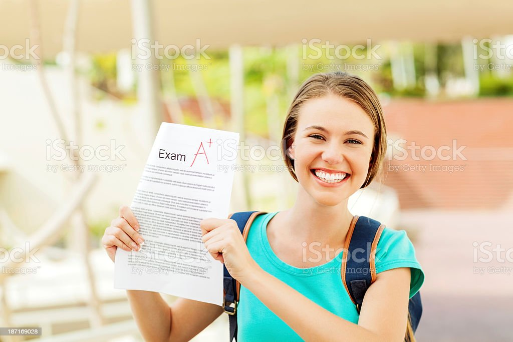 Student Showing Test Result With A+ Grade On University Campus royalty-free stock photo