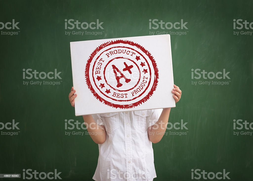 student shows his grade stock photo