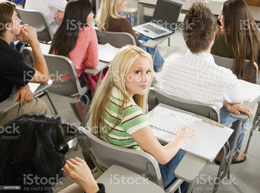 Student Sitting in Desk During Class stock photo