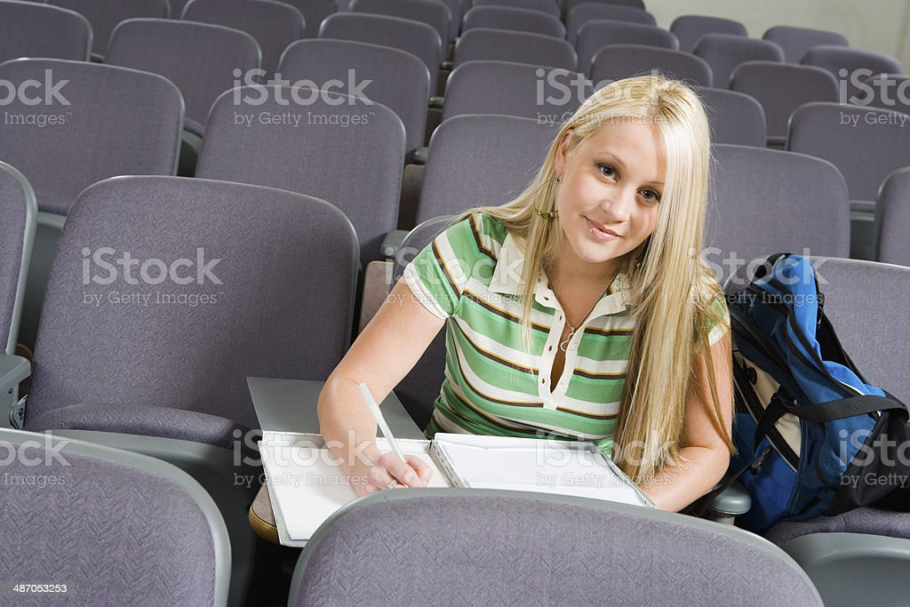 Student Sitting in Lecture Hall stock photo