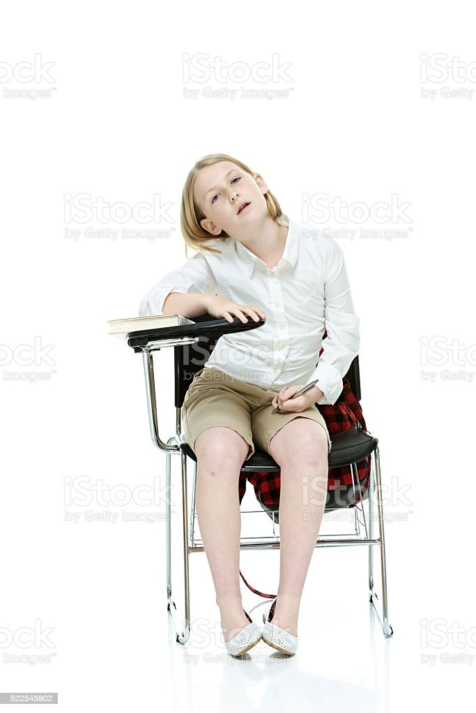 Student sitting on writing chair stock photo