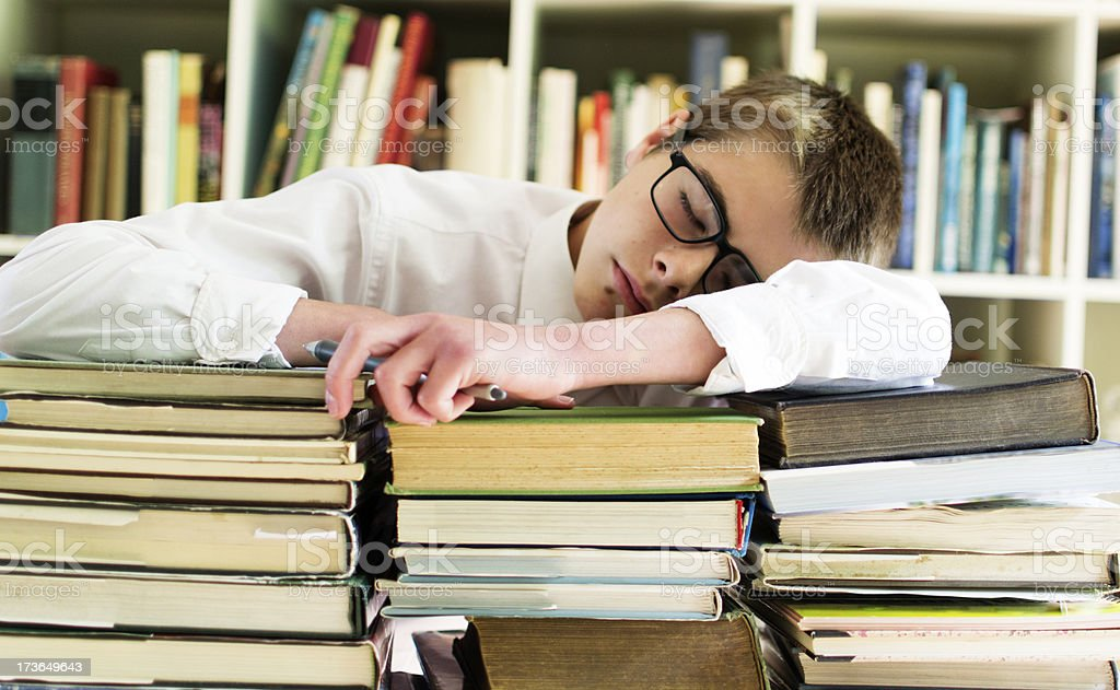Student sleeping in the library stock photo
