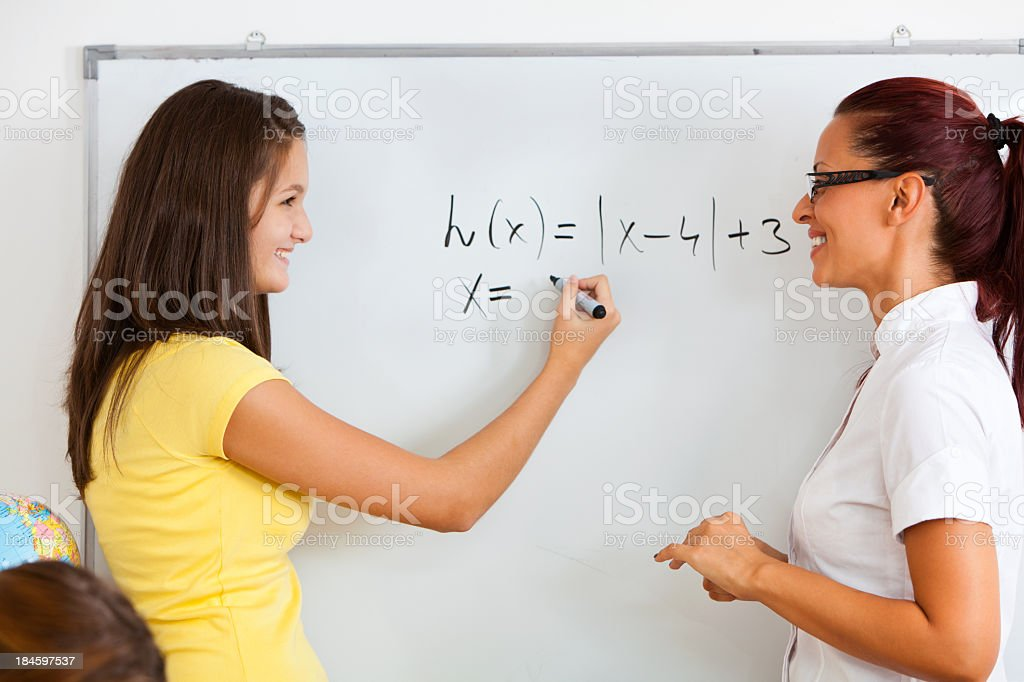 Student Solving Math Equation At School royalty-free stock photo