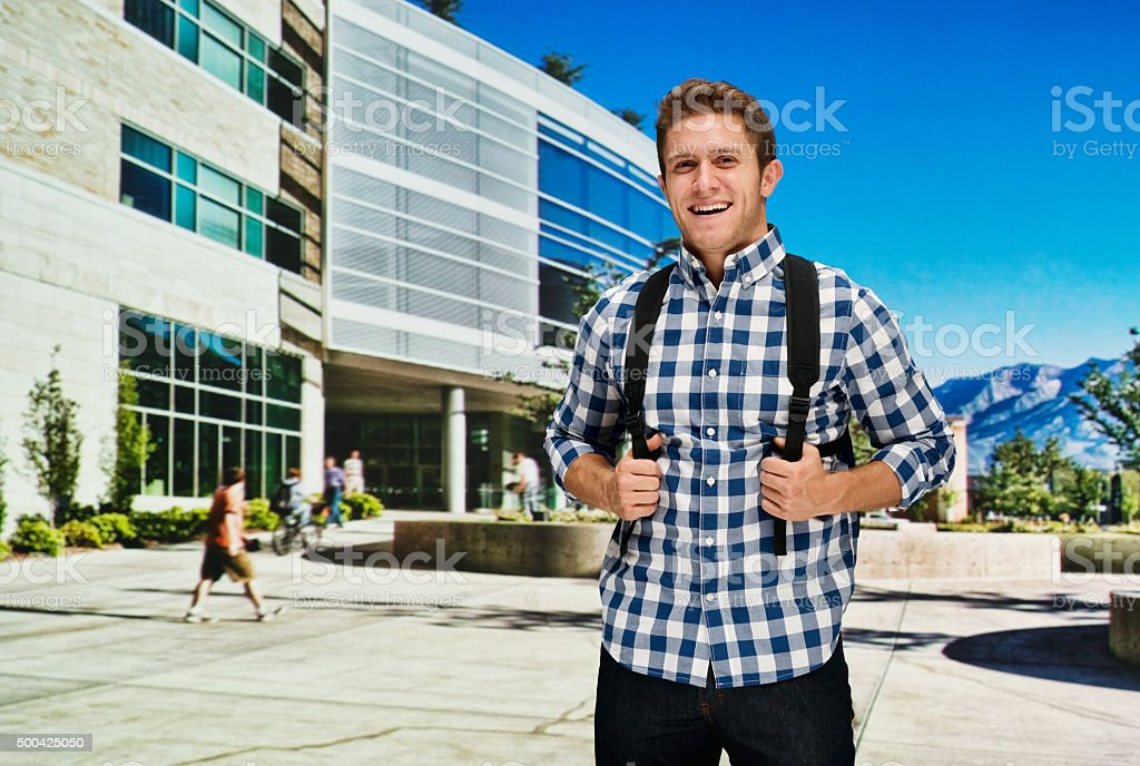 Student standing at University campus stock photo