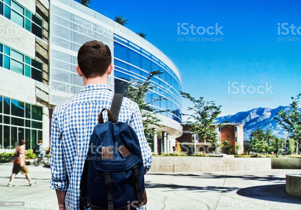 Student standing in campus stock photo