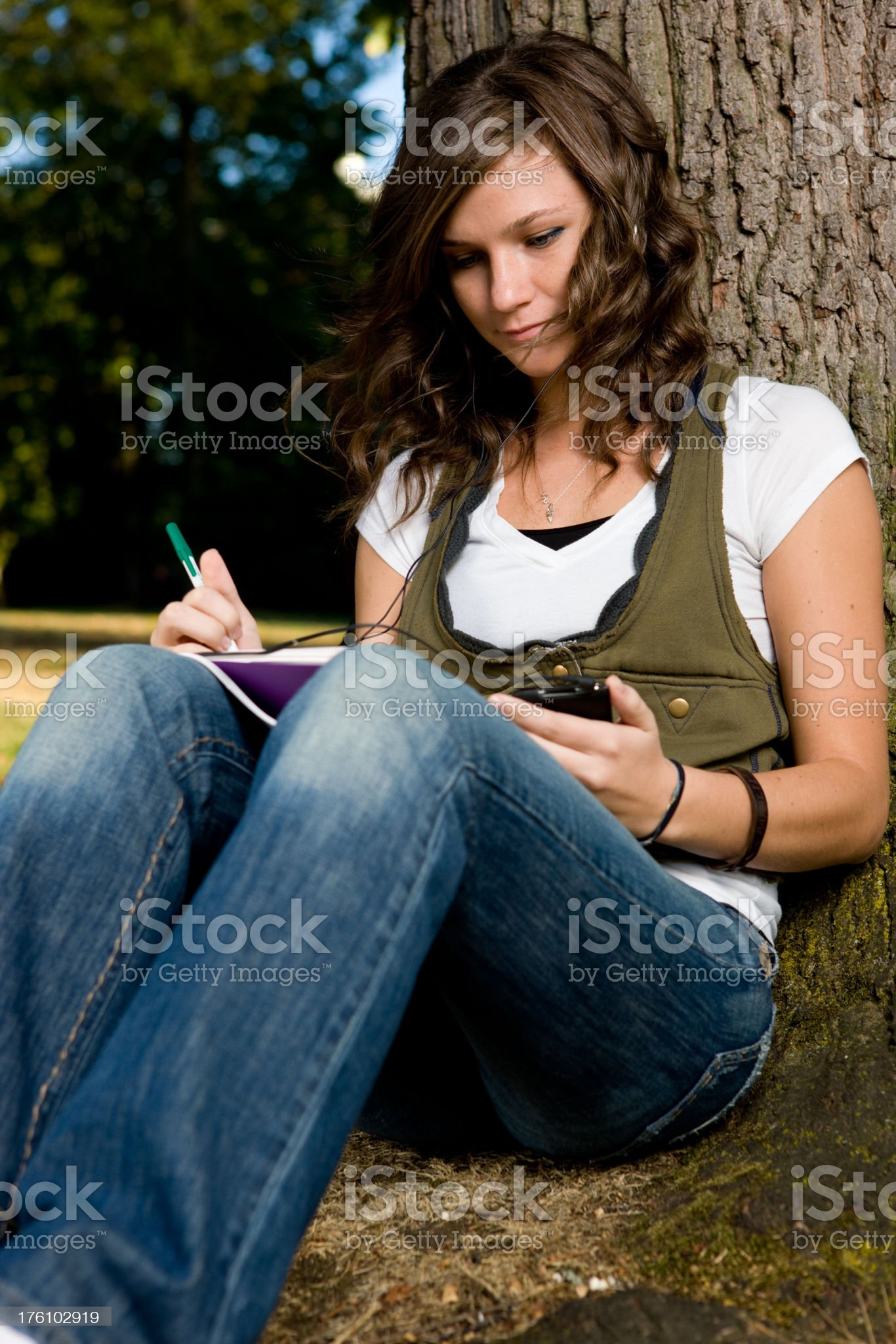 Student Studies Seriously While Listening To Music royalty-free stock photo