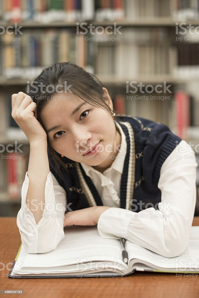 Student studying at a desk in library royalty-free stock photo