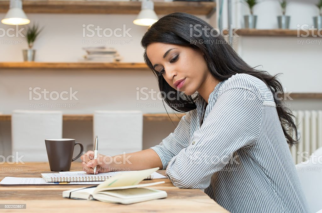 Student studying for the exam stock photo