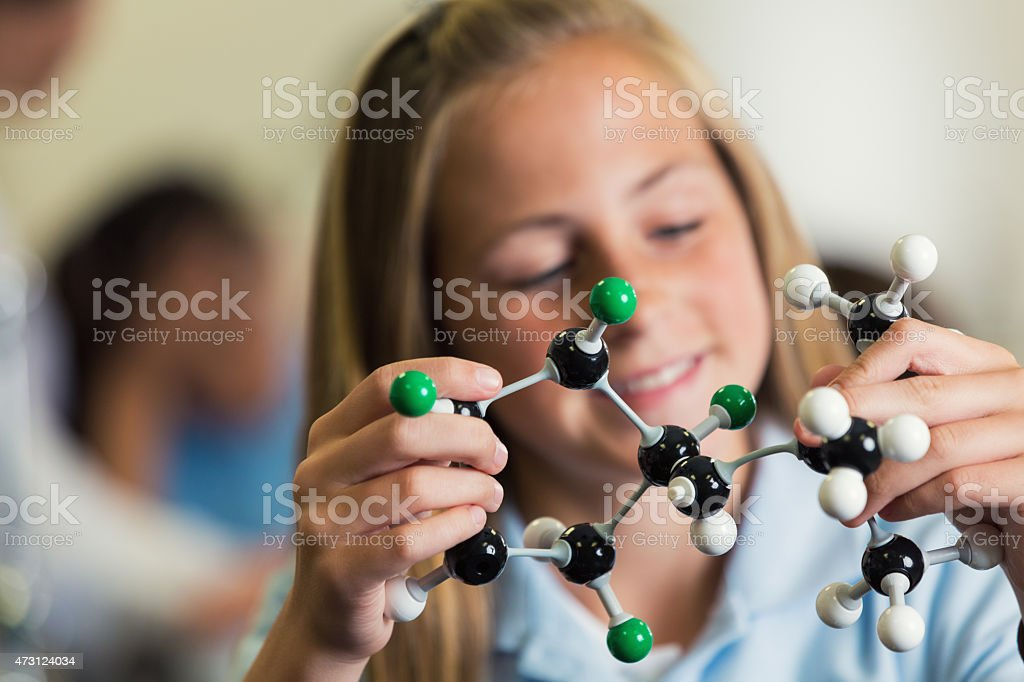 Student studying molecule science model in private school class stock photo