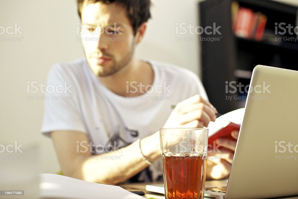 Student Studying With Drink stock photo