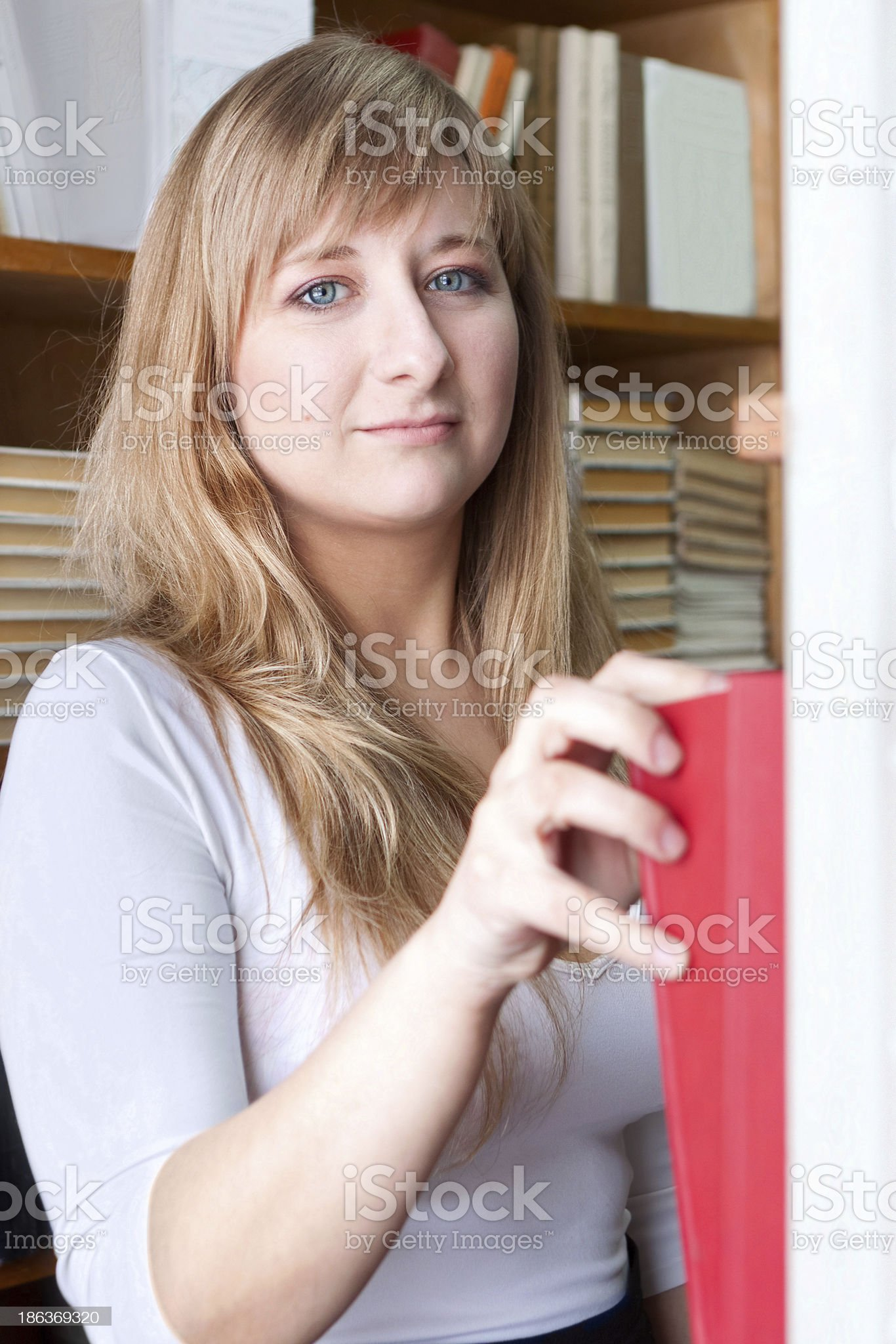 student takes book royalty-free stock photo
