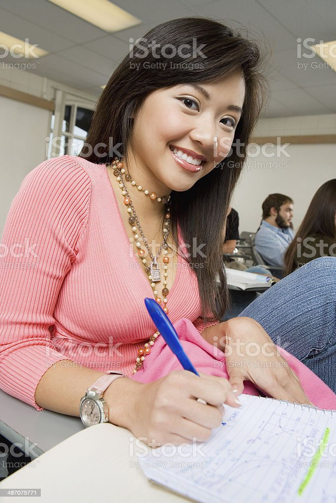 Student Taking Notes During Class stock photo