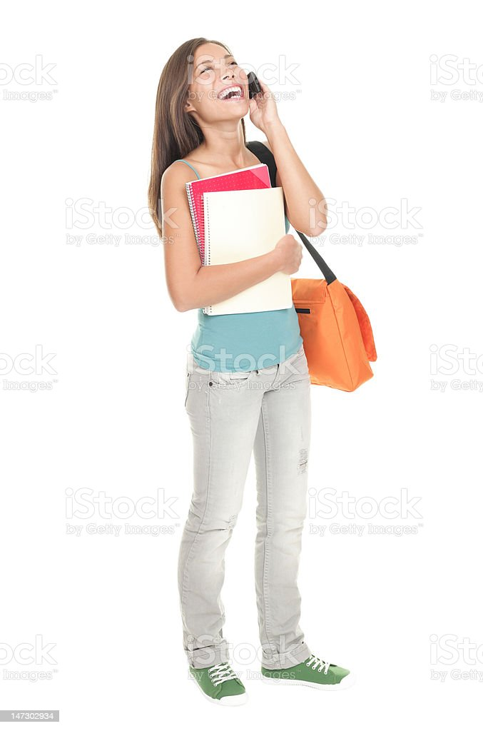 Student talking on phone standing isolated in full length royalty-free stock photo